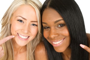 Two smiling woman showing off their teeth after Teeth Bonding in Bloomington IL
