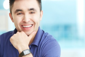 A smiling man with Adult Braces in Bloomington IL
